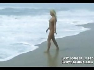 Nude blonde babe walks on the beach and then gets hammered