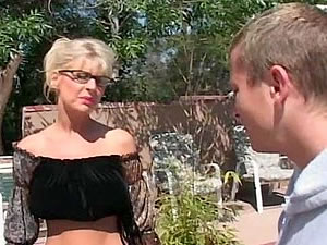 Horny mature lady seduces a nice guy outdoor