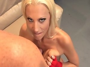 Blonde fucking on a couch in fishnet stocking